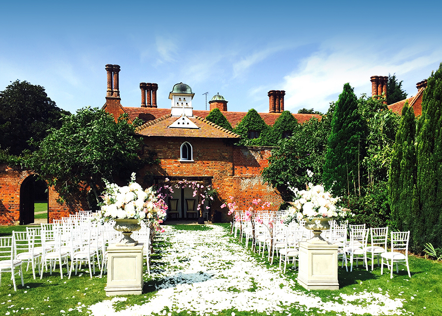 Outdoor wedding at Woodhall Manor with white petals